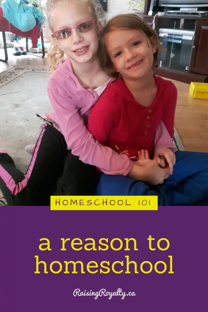 Two sisters cuddling shows that family values are one reason to homeschool