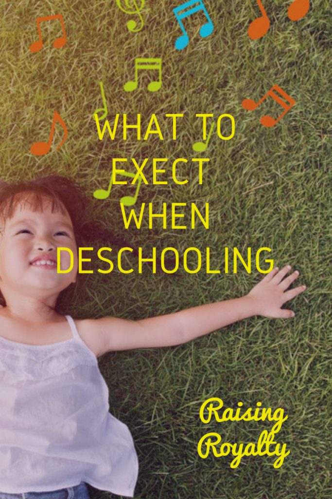 A child lays in the grass, a common thing to expect when deschooling.