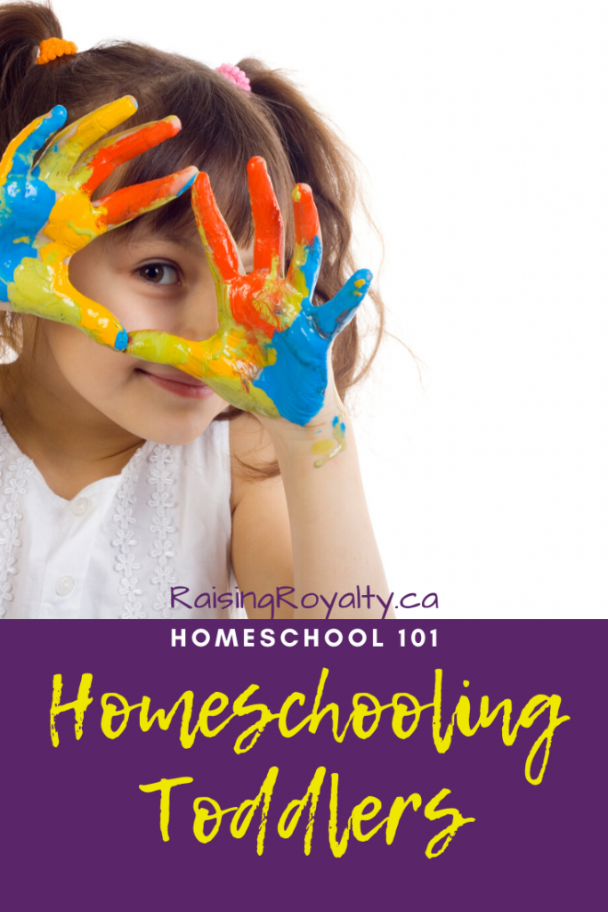 "A young child peeks through her painted hands. Should you homeschool toddlers? The whys & hows of ""tot school"" and why you might not need to do anything special at all!"